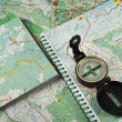 Stock Photo: Compass on detailed maps