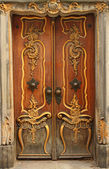 Old door with gold ornaments — Stock Photo