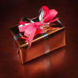 Gift box on black background - Stock Photo