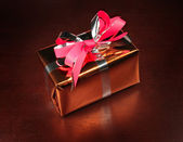 Gift box on black background — Stock Photo