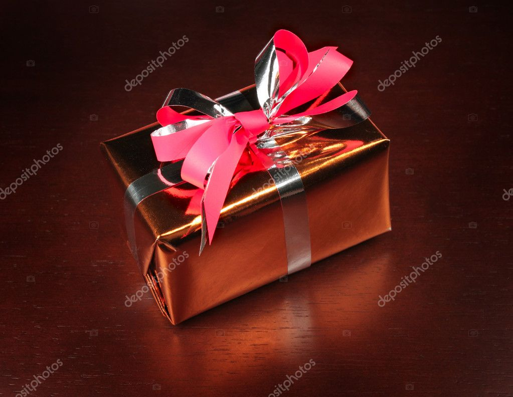 Small, red gift box with red ribbon on black background — Stock Photo #2029263