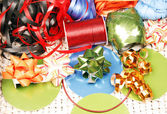 Ribbons, bows and cards — Stock Photo