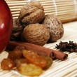 Apple, walnuts, cinnamon, berri — Stock Photo