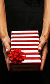 Business woman giving a gift — Foto Stock