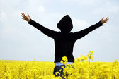 Young girl in a rape field — Foto Stock