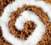 Spiral with white and brown sugar — Foto Stock