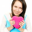 Woman giving a heart gift — Stock Photo