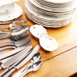 Dishes and cutlery set — Stock Photo #2573074
