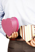 Businessman hiding a gift — Stockfoto