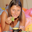 Young blond woman in bed for breakfast — Stock Photo #2545042