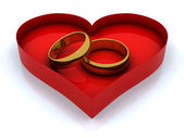 Heart box and golden rings — Stock Photo