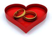 Pudełko serce i złote pierścienie — Zdjęcie stockowe