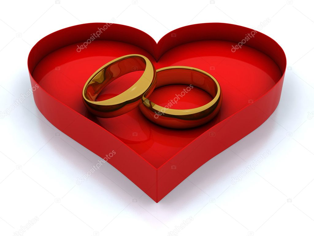 Red heart box and golden wedding rings — Stock Photo #2038007