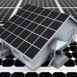 House on solar panels - Stock Photo