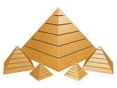 Group of golden pyramids — Stock Photo