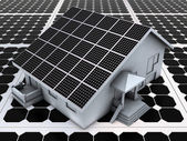 House on solar panels — Stockfoto