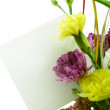 Bouquet with blank card — Stock Photo