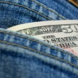 Dollars in jeans' pocket — Photo