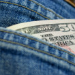Dollars in jeans' pocket — Stock fotografie