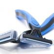 Two blue shavers on white — Stock Photo