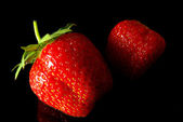 Strawberries on black — Stock Photo