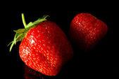 Strawberries on black — Stock Photo