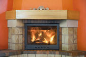 Cosy fireplace — Stock Photo