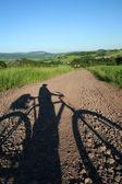 Bicyclist's shadow — Stock Photo