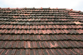 Old roof coated by rooftiles — Stock Photo