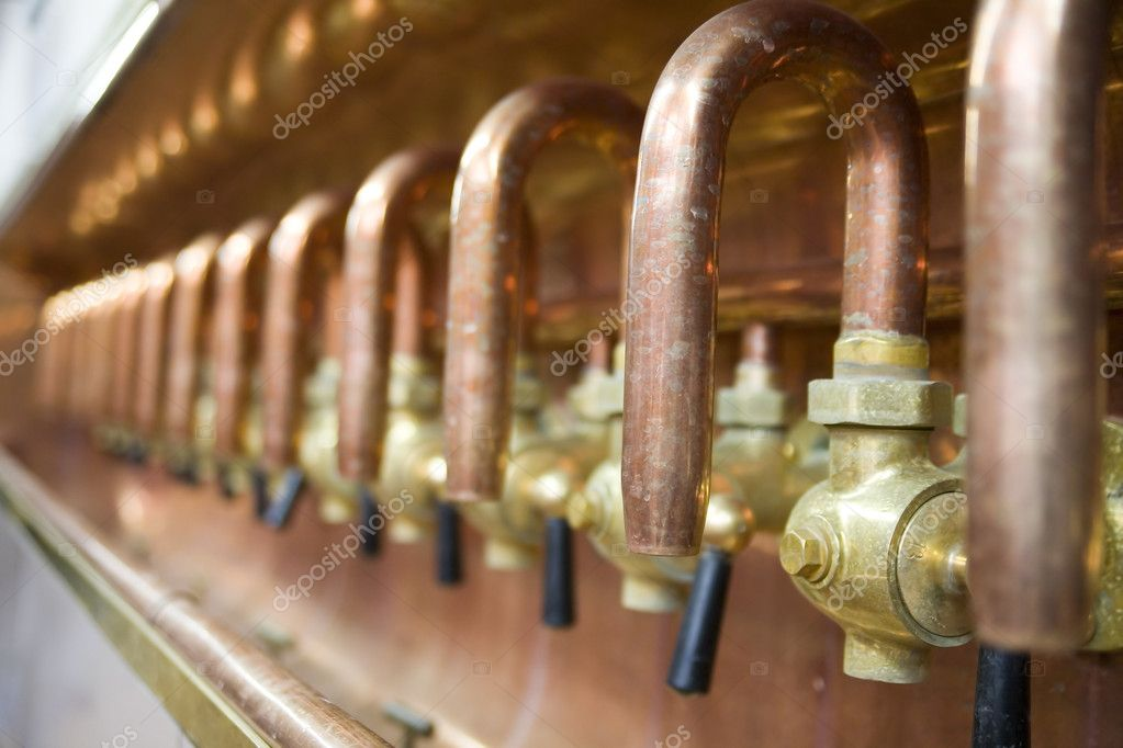 Lots of taps in brewery for checking beer quality — Stock Photo #2005044
