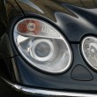 Stock Photo: Headlamp of expensive car