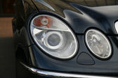 Headlamp of expensive car — Stock Photo