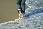 Woman walking on the beach — Stock Photo