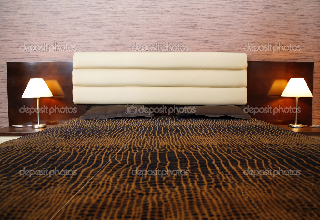 Comfortable bed and two lamps  Stock Photo #2024579