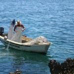 Fisherman on the coast — Stock Photo
