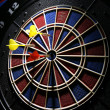 Dart board with three darts — Foto Stock