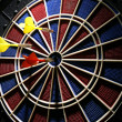 Dart board with three darts - Stockfoto