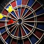 Dart board with three darts — Stock Photo