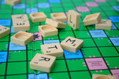 Mess on the scrabble board — Stock Photo