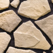 Fragment of sandstone wall — Stock Photo