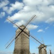 Windmills and a small man — Stock Photo