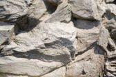 Fragment of rocky wall — Stock Photo