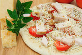Un-cooked Chicken And Cheese Pizza — Stock Photo