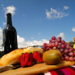 Stock Photo: Fruit and Wine Picnic