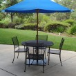 Wrought Iron Table With Umbrella — Stock Photo #2225689
