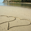 图库照片: Two hearts on a beach