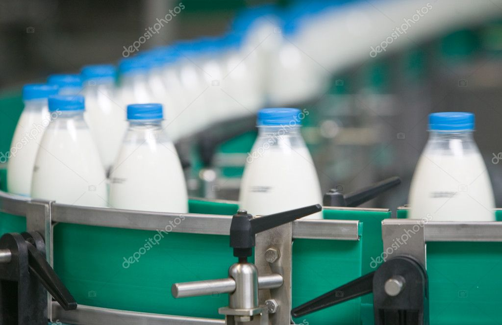 Dairy Plant. Conveyor with milk  bottles. — Stock Photo #2043080