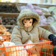 Little boy in shopping cart — Stock Photo