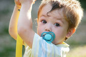 Little boy with pacifier — Stock Photo