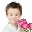 Boy and roses — Stock Photo